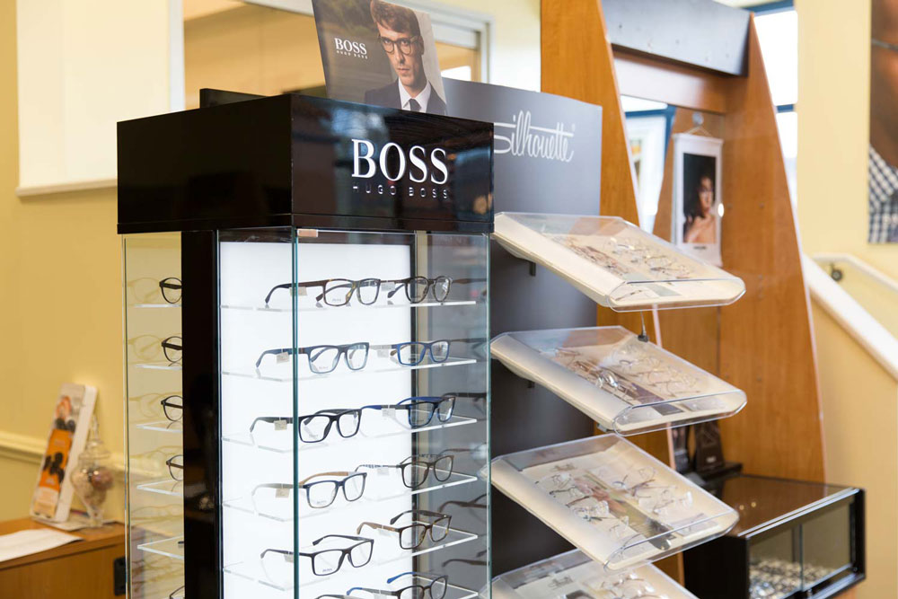 Maintained eyeglasses in a glass showcase at MAIN Fashion Optical in New Jersey