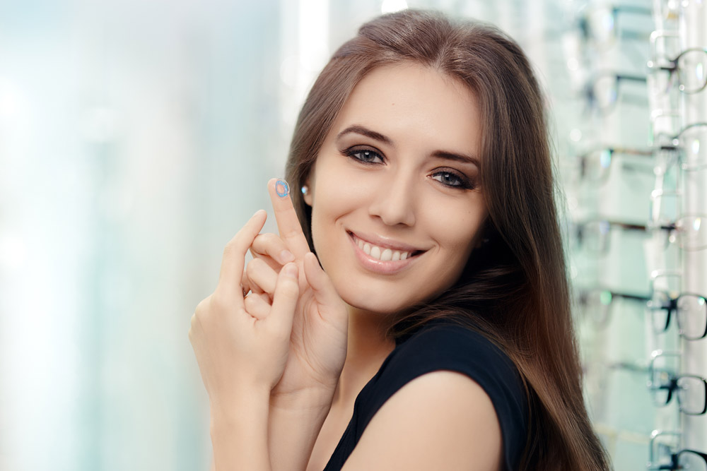 women holding contact lenses on her finger. Contact lenses at MAIN Fashion Optical Store New Jersey
